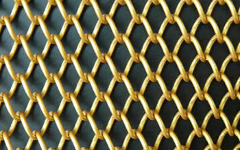 A piece of aluminum decorative woven wire mesh with gold colors.